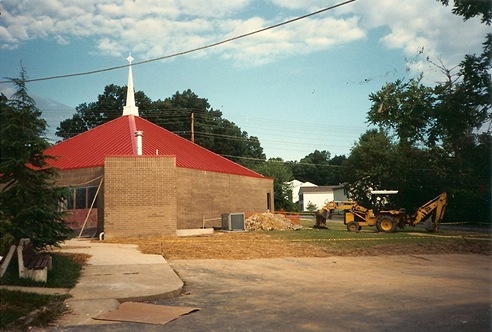 The new church (red roof and all) near completion - 1995